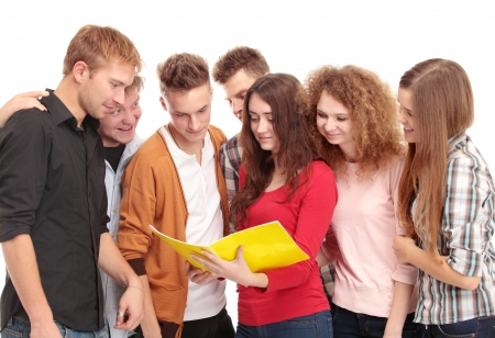Group of students talking and holding notebooks outdoors Stock Photo