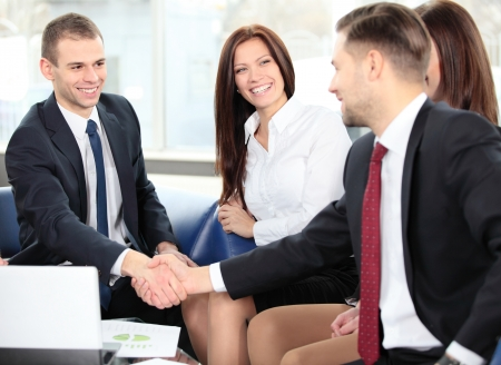 hands joined: Business people shaking hands, finishing up a meeting Stock Photo