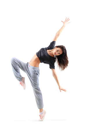 hip hop style: pretty modern slim hip-hop style teenage girl jumping dancing isolated on a white studio background