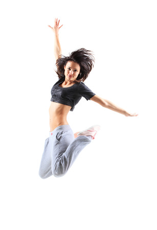 break dancer: pretty modern slim hip-hop style teenage girl jumping dancing isolated on a white studio background