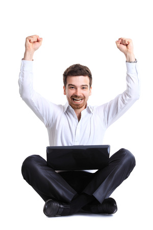 Business man celebrating his success with a computer laptop  photo