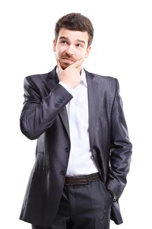 persona pensando: Hombre de pensamiento aislado en fondo blanco Retrato de un hombre de negocios pensativo joven casual mirando copyspace modelo masculino de raza caucásica