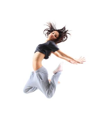 ziemlich modern schmal Hip-Hop-Stil-Springen Teenager-Mädchen tanzen auf einem weißen Studio-Hintergrund