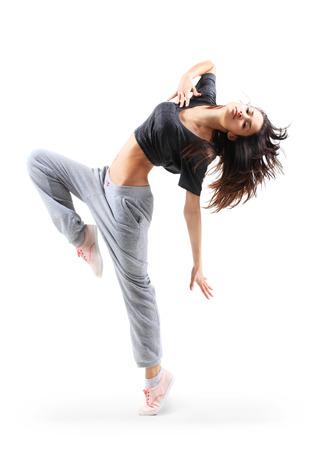 흰색 studio 배경에 고립 꽤 현대 슬림 힙합 스타일 십 대 소녀 점프 춤 스톡 콘텐츠