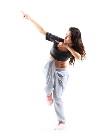 hip hop pose: modern style dancer posing on studio background  Stock Photo