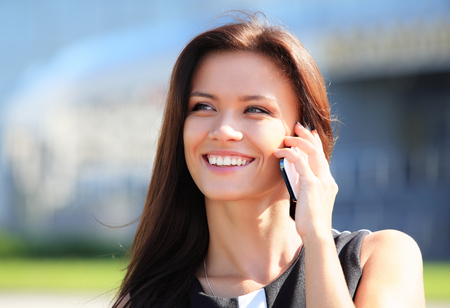Young businesswoman having a conversation using a smartphone on a phone call photo