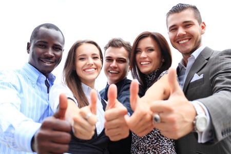 look up: Successful young business people showing thumbs up sign