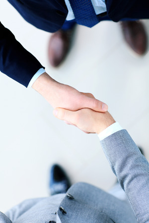 Close-up van een bedrijf handdruk