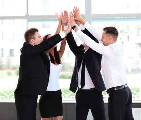 winning business woman: Pile of hands - Successful business team celebrating their success with a high five