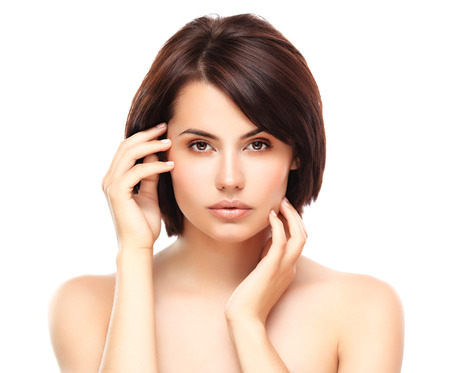 white girl: Beautiful Girl Touching Her Face  Isolated on a White Background  Perfect Skin  Beauty Face  Professional Makeup  Stock Photo