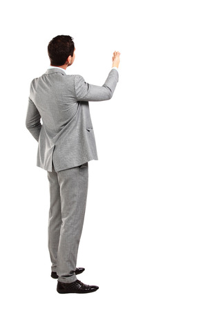 left behind: business man from the back - looking at something over a white background Stock Photo