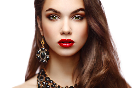 brown hair blue eyes: Beauty Model Woman with Long Brown Wavy Hair  Healthy Hair and Beautiful Professional Makeup  Red Lips and Smoky Eyes Make up  Gorgeous Glamour Lady Portrait  Haircare, Skincare concept