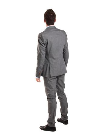 뒤쪽에서 비즈니스 남자 - 흰색 배경 위에 뭔가 찾고