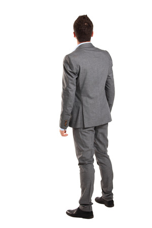 watch over: business man from the back - looking at something over a white background
