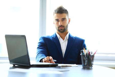good looking guy: Businessman using laptop
