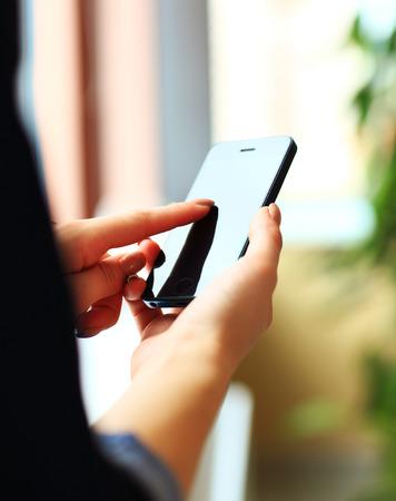 Woman hands touching smartphone bright background, closeup Banco de Imagens - 31832228