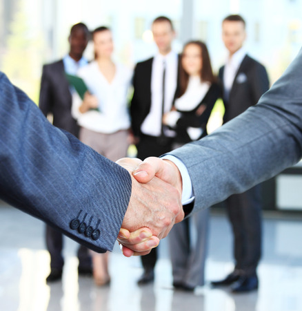 team success: Closeup of a business handshake. Business people shaking hands, finishing up a meeting