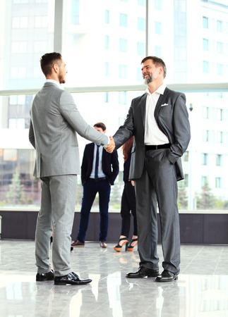 technology deal: Business handshake. Handshake of two business men closing a deal at the office