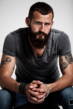 tattoo face: Portrait of handsome bearded man with tattoos Stock Photo