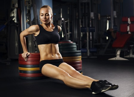 muscle woman: beautiful muscular fit woman exercising building muscles