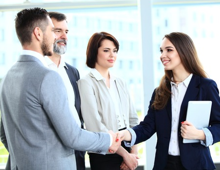 Business people shaking hands, finishing up a meeting Stock Photo - 35868010