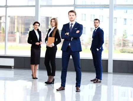 white collar worker: Group portrait of a professional business team looking confidently at camera