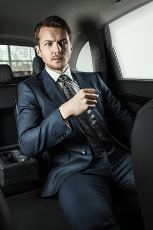 luxury lifestyle: Businessman in the car