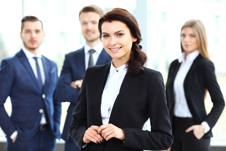 latin look: Face of beautiful woman on the background of business people