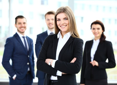 staff team: Face of beautiful woman on the background of business people
