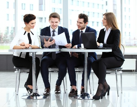 Image of business partners discussing documents and ideas at meeting Banco de Imagens - 40208979