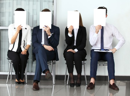Human resource concept, Young businessman holding white billboard and waiting for job interview Standard-Bild