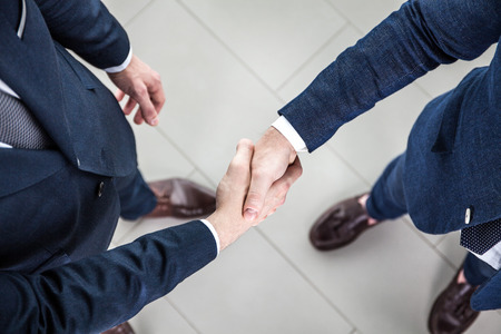 group of hands: Business people shaking hands, finishing up a meeting Stock Photo