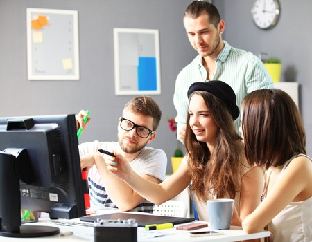 sales bank: Group of designers in office Stock Photo