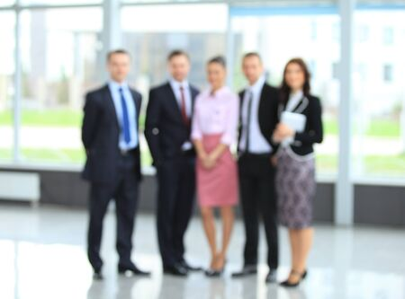 business center: abstakt image of people in the lobby of a modern business center with a blurred background