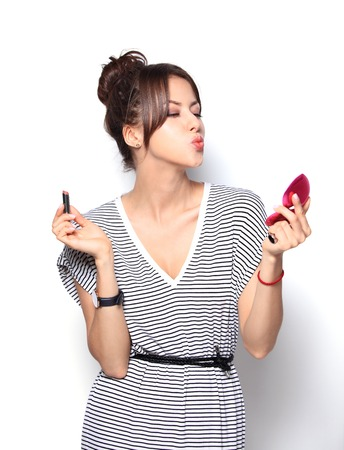 lipstick kiss: beautiful woman is applying her lips with red lipstick Stock Photo