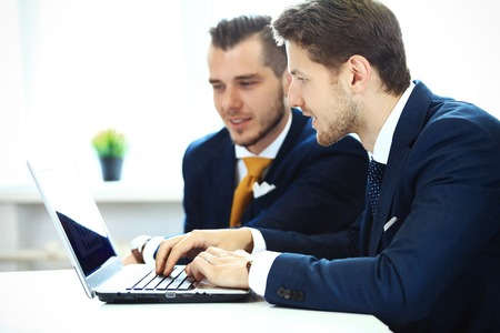 technology career: Two confident businessmen networking in office