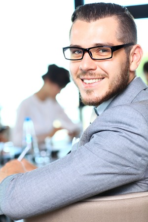 professional portrait: Businessman with colleagues in the background