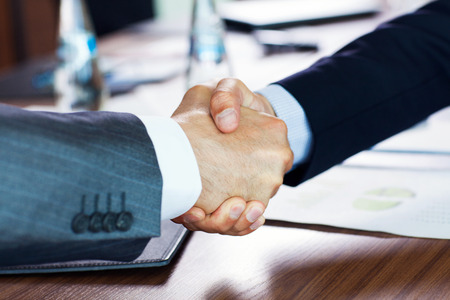 team power: Business people shaking hands, finishing up a meeting Stock Photo