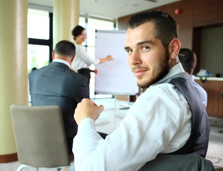 happy business team: Businessman with colleagues in the background