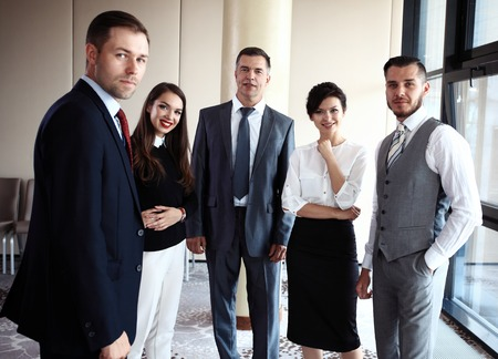 group of men: Happy smiling business team in office