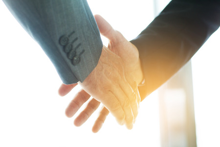 the human hand: Business people shaking hands, finishing up a meeting Stock Photo