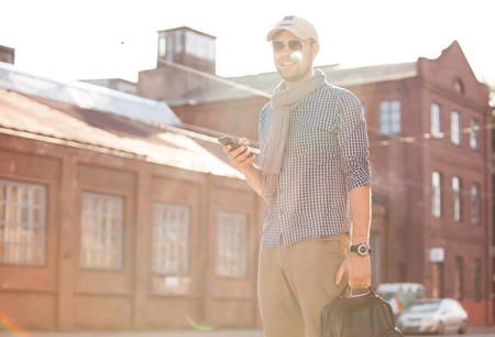 phone professional: Young urban businessman professional on smartphone walking in street using app texting sms message on smartphone