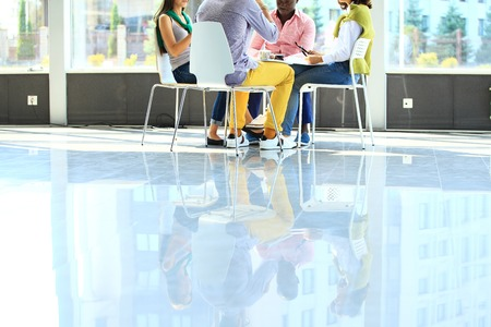 circulo de personas: Creative business people meeting in circle of chairs Foto de archivo