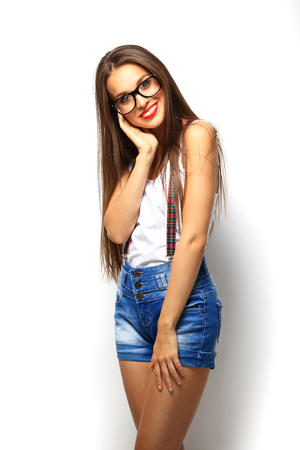 glasses model: High fashion look.glamor stylish beautiful young woman model with red lips in summer bright colorful hipster cloth Stock Photo