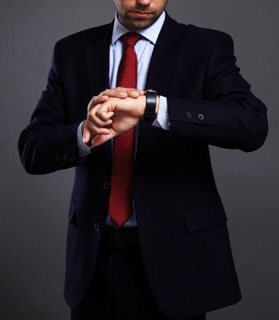 businessman suit: man in the suit on black