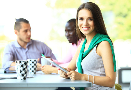 hispanic woman: Face of beautiful woman on the background of business people