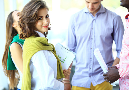 business casual: Face of beautiful woman on the background of business people
