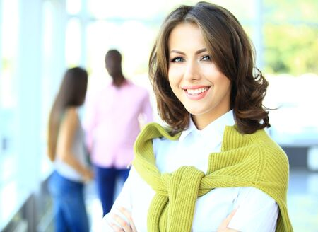 face work: Face of beautiful woman on the background of business people