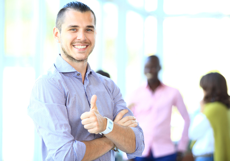 ok hand: Businessman showing OK sign with his thumb up. Selective focus on face. Stock Photo