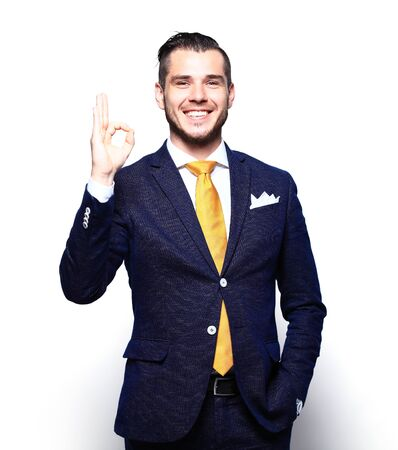 man business: Happy smiling young business man with thumbs up gesture, isolated over white background Stock Photo